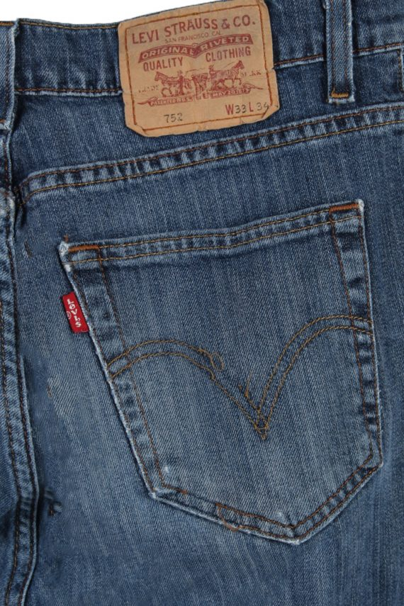 Vintage Levi's 752 Red label Ripped Faded Unisex Jeans W33 L34 Blue J3295-85066